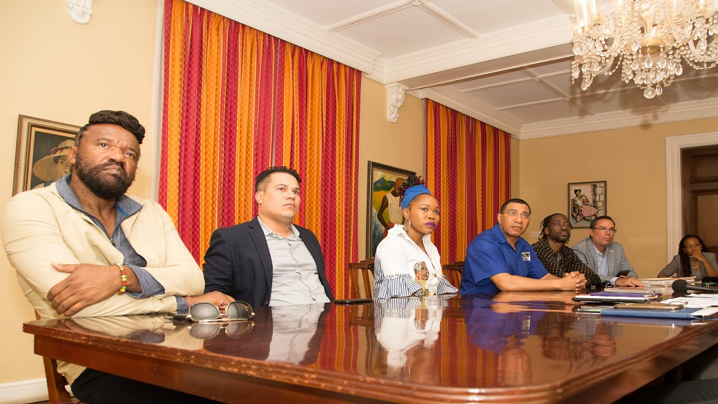Prime Minister Andrew Holness (centre) with (from left) reggae singer Tony Rebel; Government Senator Matthew Samuda; entertainer Queen Ifrica; dancehall star Bounty Killer; Cabinet Minister Daryl Vaz and OPM Press Secretary Naomi Francis during a meeting at Vale Royal on Wednesday.