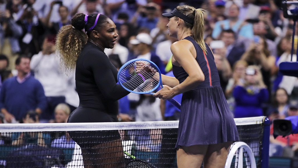 Serena Williams, left, shakes hands with Maria Sharapova after their first-round match at the U.S. Open tennis tournament in New York, Monday, Aug. 26, 2019. Williams won. (AP Photo/Charles Krupa)