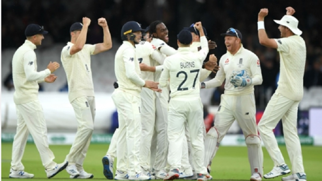 England celebrate Jofra Archer's first Test wicket.