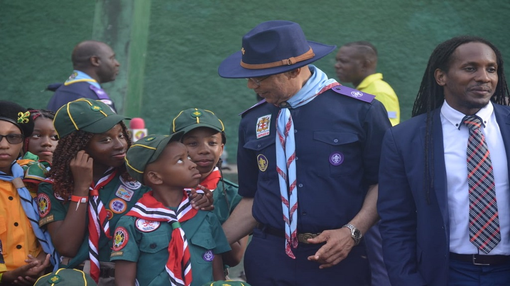 Governor General Sir Patrick Allen (second right) has the attention of Scouts Caribbean Cuboree at the Ocho Rios High School in St Ann on Tuesday. Minister of State in the Ministry of Education, Youth and Information, Alando Terrelonge is at right.
