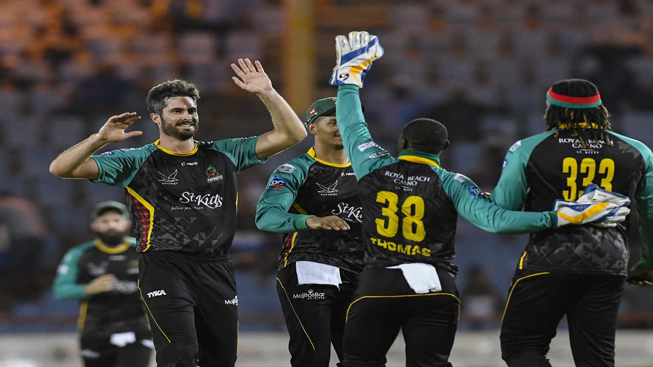 Ben Cutting (left) of St Kitts & Nevis Patriots celebrates the dismissal of Darren Sammy of St Lucia Stars during match 13 of the Hero Caribbean Premier League at the Darren Sammy Cricket Ground on August 21, 2018. (PHOTO: CPL via Getty Images).