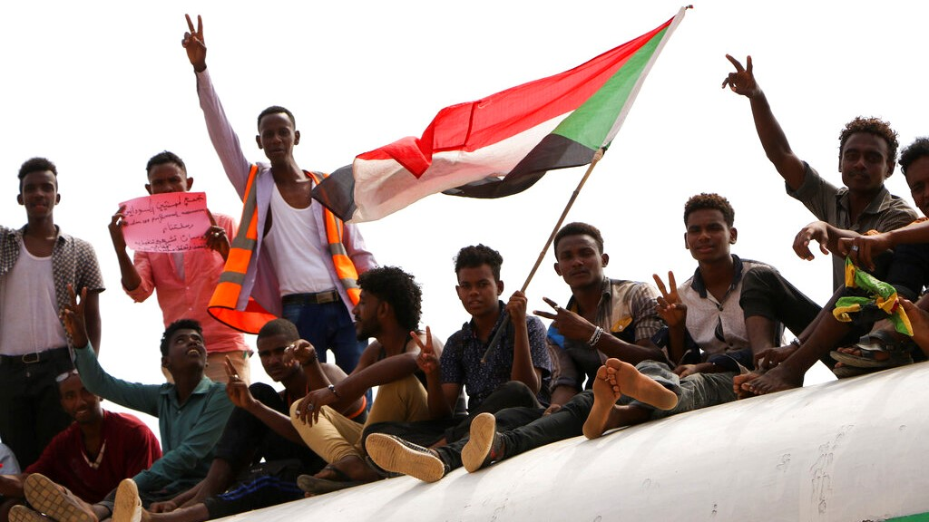 Sudanese pro-democracy supporters celebrate a final power-sharing agreement with the ruling military council Saturday, Aug 17, 2019, in the capital, Khartoum. (AP Photo)
