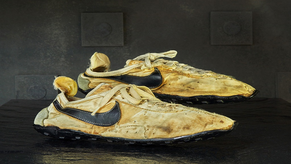 This undated photo provided by Graduate Hotels shows a pair of handmade Nike track shoes from the 1972 Olympic trials. The pair of Nike track shoes has sold for $50,000. (Christian Horan/Graduate Hotels via AP).
