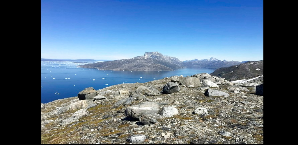 In this image taken on June 15, 2019 small pieces of ice float in the water in Nuuk Fjord, Greenland. Milder weather than normal in Greenland since the start of summer, led to the UN's weather agency voicing concern that the hot air which produced the recent extreme heat wave in Europe could be headed toward Greenland where it could contribute to increased melting of ice.
