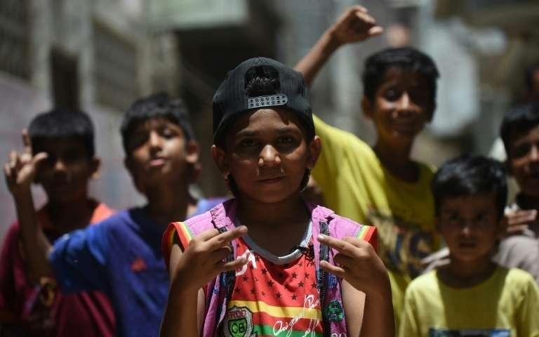 Waqas Baloch, 8 ans, rappe dans les rues de Lyari, à Karachi (Pakistan), le 19 mai 2019 afp.com - RIZWAN TABASSUM