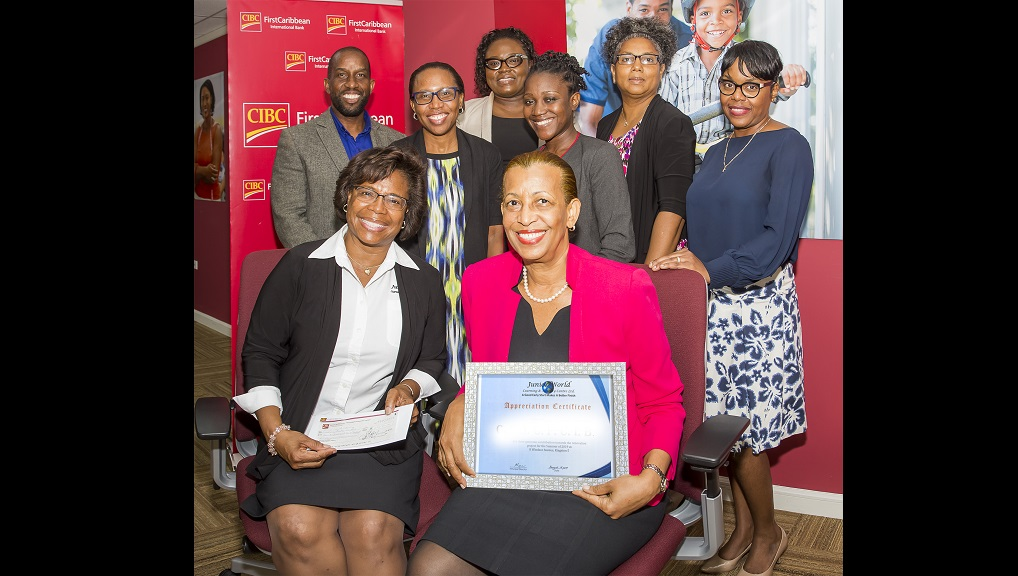 Following the presentation of a cheque by CIBC FirstCaribbean's Adopt-A-Cause programme for the upgrading of facilities at Junior World Learning and Activity Centre (seated l-r) Andrea Lyn, Principal Director of the school; Jennifer Brown, Director, Centralized Operations Services of the bank and (standing l-r)  Leonard Bennett, Principal; and bank executives Nicola McKenzie; Kady-Ann Hamilton; Latoya Kerr-Gordon; Claire Williams and Judith Najar.