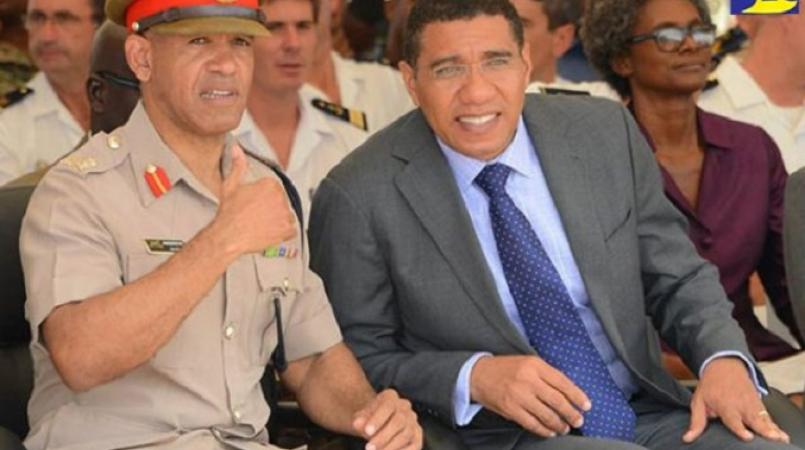 Prime Minister Andrew Holness (right) with Police Commissioner, Major General Antony Anderson. (PHOTO: File)