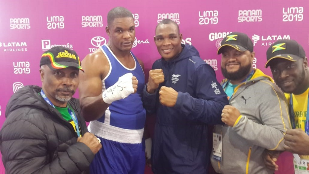 Jamaica's super heavyweight (91+kg.) boxer, Ricardo Brown (second left), celebrates winning the Pan American bronze medal in Lima, Peru. Sharing in the celebration are (from left) Christopher Samuda, JOA President, Colombia's Salzedo Codazzi, who beat him in the semis, Ryan Foster, JOA CEO/Secretary General, and Jamaica's boxing coach, Gilbert Vaz.