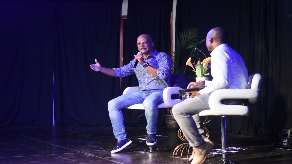 People's National Party (PNP) presidential candidate, Peter Bunting (left) responding to a question at a town hall meeting in New Kingston on Thursday. At right is moderator, George Davis. (Video and photos: Marlon Reid)
