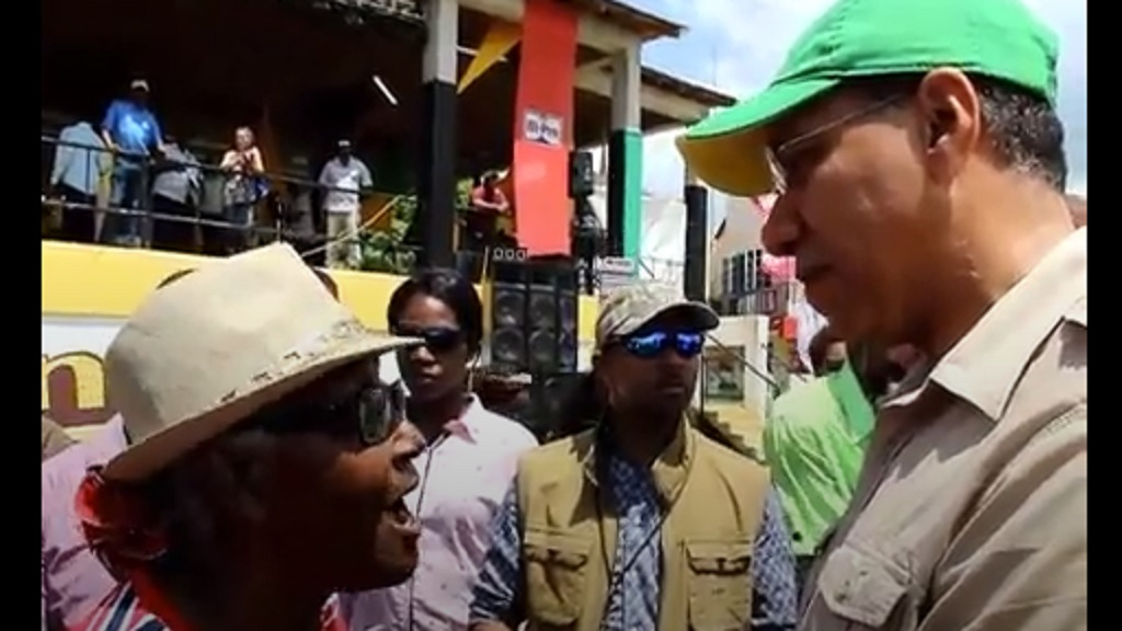 Loris Banton belting out words of advice, including in song, to Prime Minister Andrew Holness at Denbigh on Tuesday.