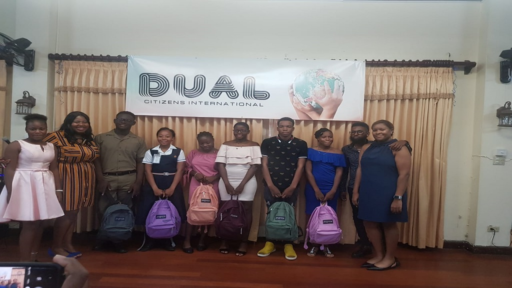 Local high school students pose with their new backpacks at a presentation ceremony hosted by charity group  Dual Citizens International Foundation.