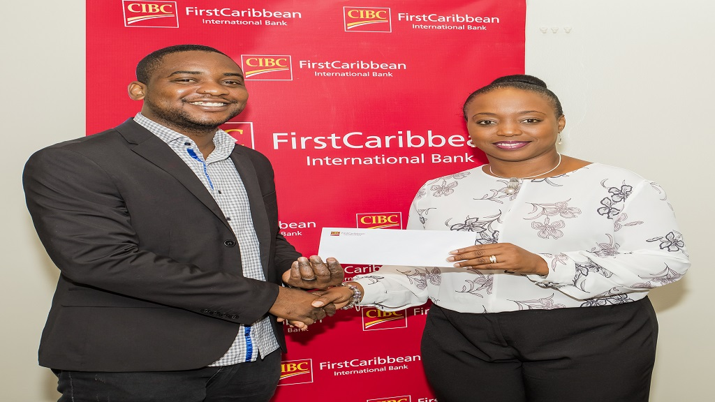 Kavan Allen (left), Pastor of Fellowship Tabernacle receives a sponsorship cheque from Renee Whitehorne, Marketing Manager, CIBC FirstCaribbean International Bank in support of GNexx Camp 2019.