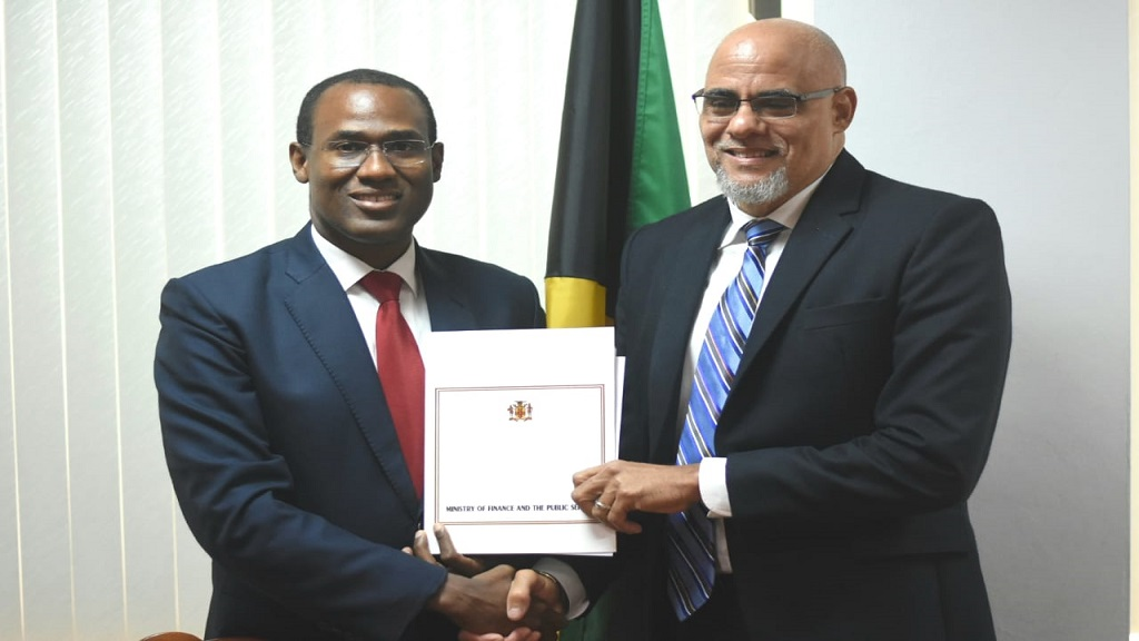 Finance Minister Dr Nigel Clarke (left) with EPOC chairman Keith Duncan following the signing of an MOU that will see EPOC maintain its monitoring role in Jamaica's economic reform programme. (PHOTO: Marlon Reid)