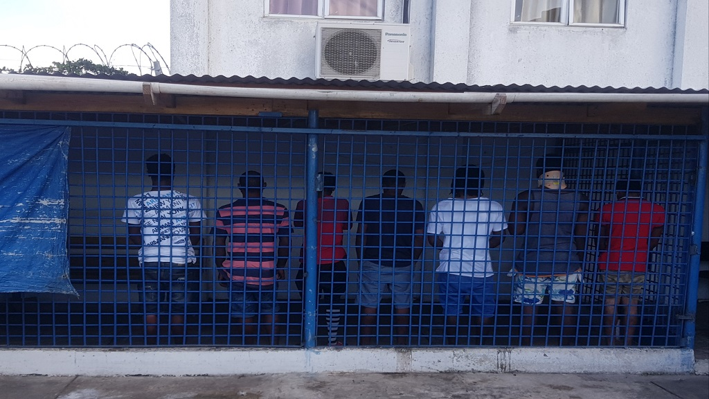 A distant photo of detainees in a state of emergency facility in St James.