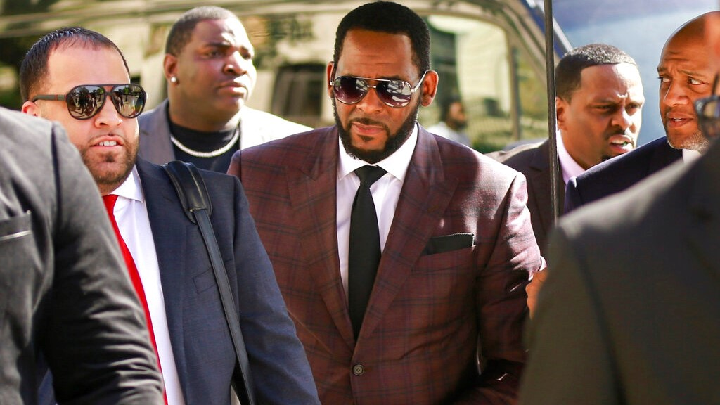 In this June 26, 2019, file photo, R&B singer R. Kelly, center, arrives at the Leighton Criminal Court building for an arraignment on sex-related felonies in Chicago.  (AP Photo/Amr Alfiky, File)