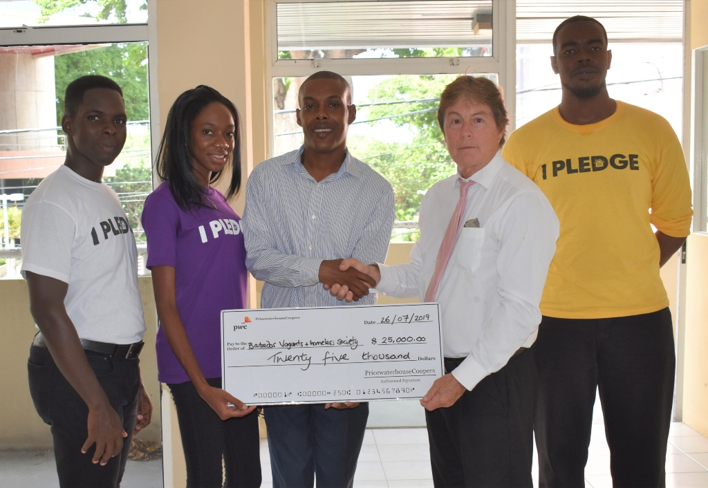 Stephen Jardine (second right) met with Kemar Saffrey (centre) at the new shelter on Spry Street accompanied by the charities team.