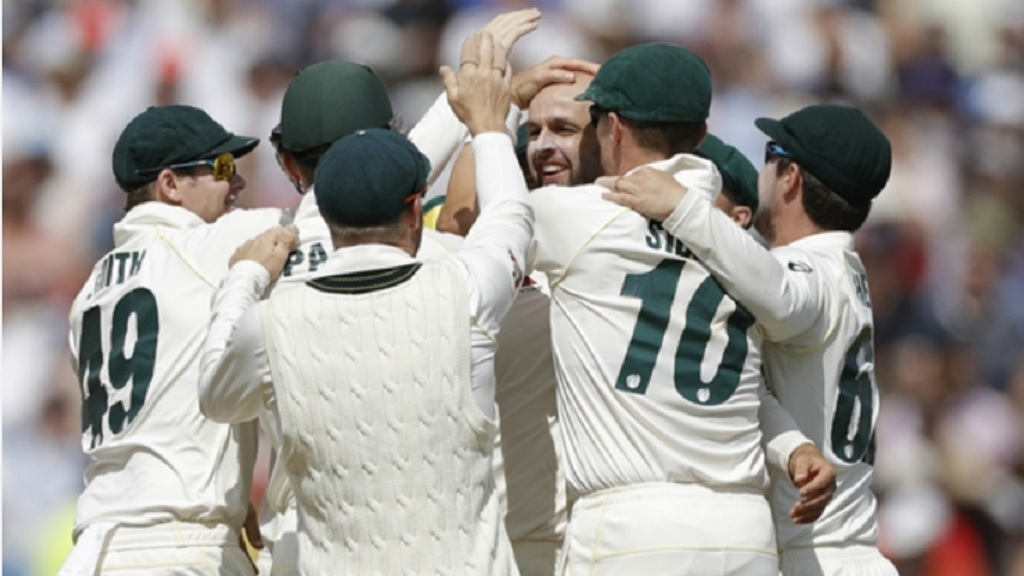 Australia celebrate with Nathan Lyon.