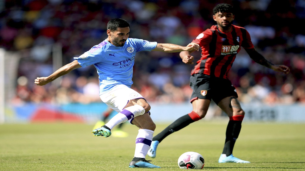 Manchester City's Ilkay Gundogan, left, and Bournemouth's Philip Billing battle for the ball during the English Premier League match between Bournemouth and Manchester City at the Vitality Stadium, Bournemouth, England, Sunday Aug. 25, 2019. (Adam Davy/PA via AP)