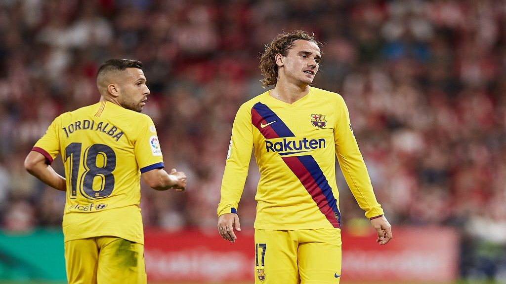 Barcelona's Antoine Griezmann, right, reacts during the Spanish La Liga football match against Athletic Bilbao at the San Mames stadium in Bilbao, northern Spain, Friday, Aug. 16, 2019.