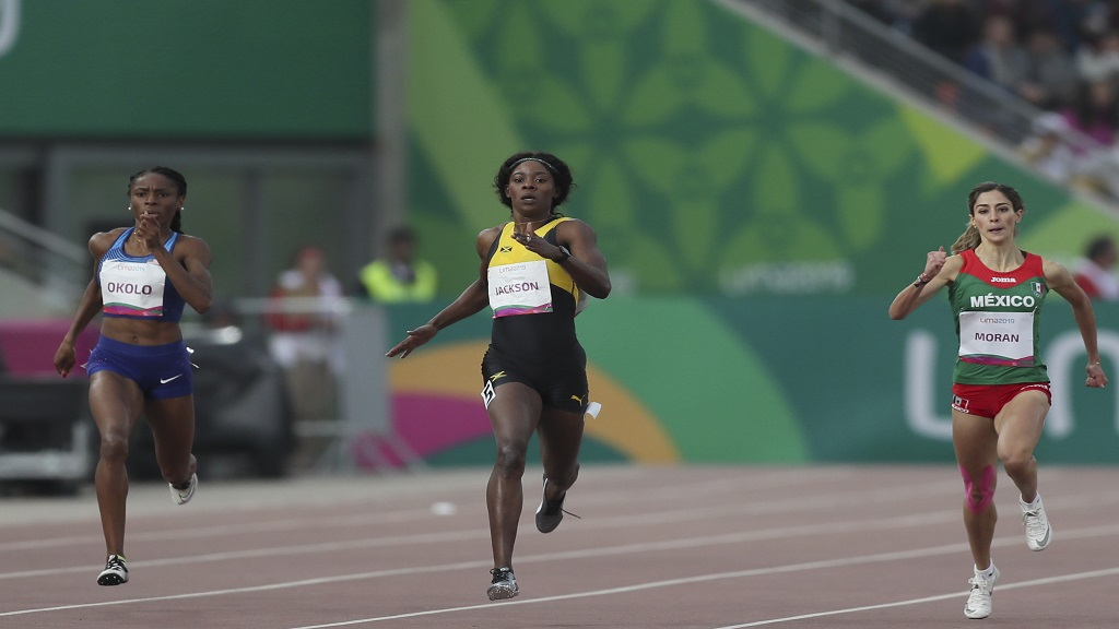 Shericka Jackson of Jamaica runs to win the gold medal in the women's 400m during the athletics at the Pan American Games in Lima, Peru, Thursday, Aug. 8, 2019. Paola Moran of Mexico, right, won the silver medal and Courtney Okolo of United States the bronze medal. (AP Photo/Fernando Llano)