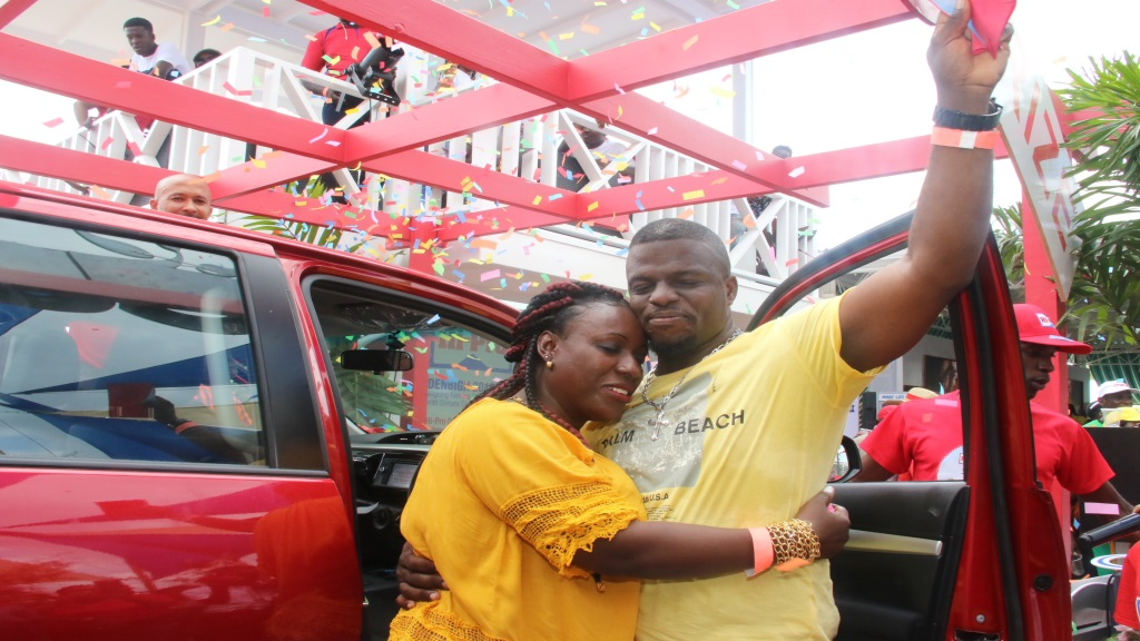 Keddon Richards gets a hug from his wife Jacqueline after winning a new Toyota Hilux pick-up courtesy of Hi-Pro.