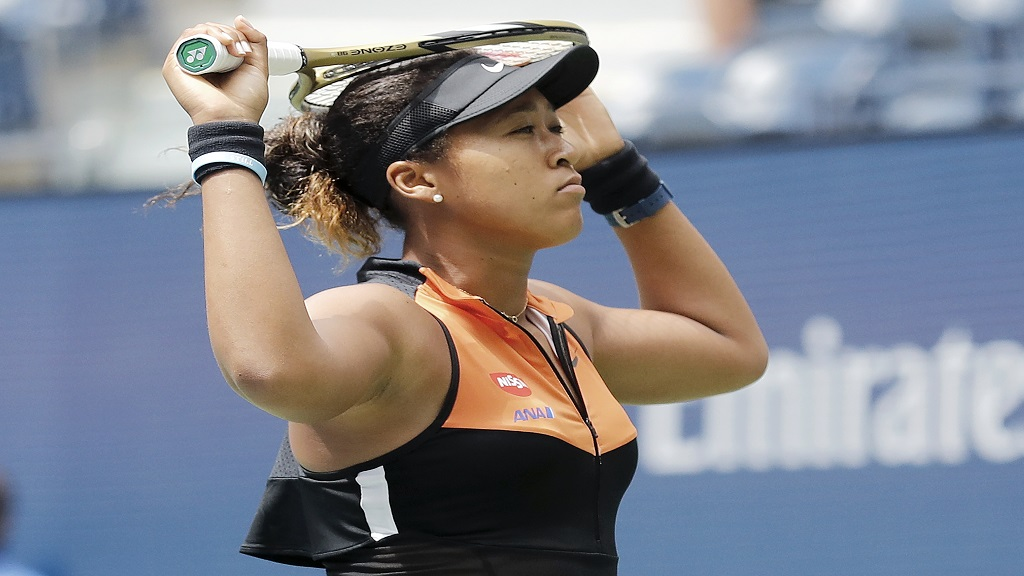 Naomi Osaka, of Japan, reacts after losing a point to Anna Blinkova, of Russia, during the first round of the US Open tennis tournament Tuesday, Aug. 27, 2019, in New York. (AP Photo/Michael Owens).