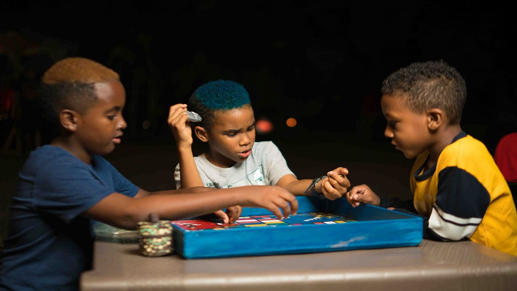 No internet, no problem: Ludo was the game of choice for this trio at the Mid-Summer Night Camp at the Hope Zoo Kingston on Saturday, July 13, 2019.