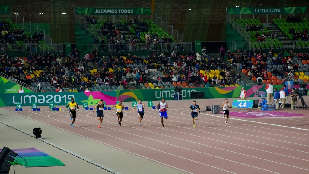 Shane Hudson (left) and Tevaughn Thomas (third left) compete in the men's T12 100m heats.
