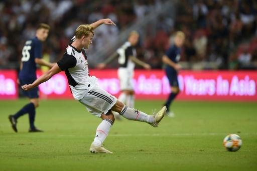 Le défenseur néerlandais Matthijs de Ligt, fraîchement arrivé à Turin, dispute un match avec la Juve contre Tottenham à Singapour, le 21 juillet 2019 afp.com - Roslan RAHMAN