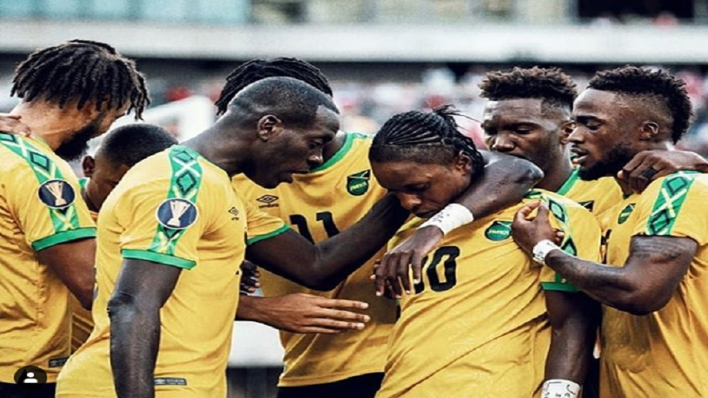 Darren Mattocks (third right) is surrounded by teammates after scoring the winning goal in Jamaica's Gold Cup quarterfinal clash against Panama on Sunday.