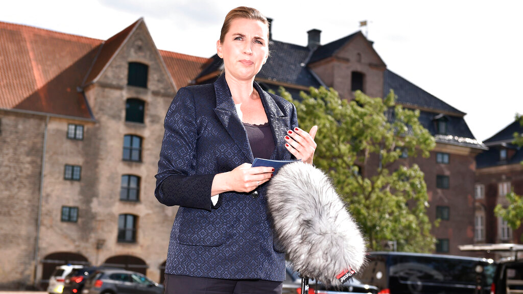 Denmark's Prime Minister Mette Frederiksen makes a comment about US President's cancellation of his scheduled State Visit, in front of the State Department in Copenhagen, Wednesday, Aug. 21, 2019. U.S. President Trump announced his decision to postpone a visit to Denmark by tweet on Tuesday Aug. 20, 2019, after Danish Prime Minister Mette Frederiksen dismissed the notion of selling Greenland to the U.S. as