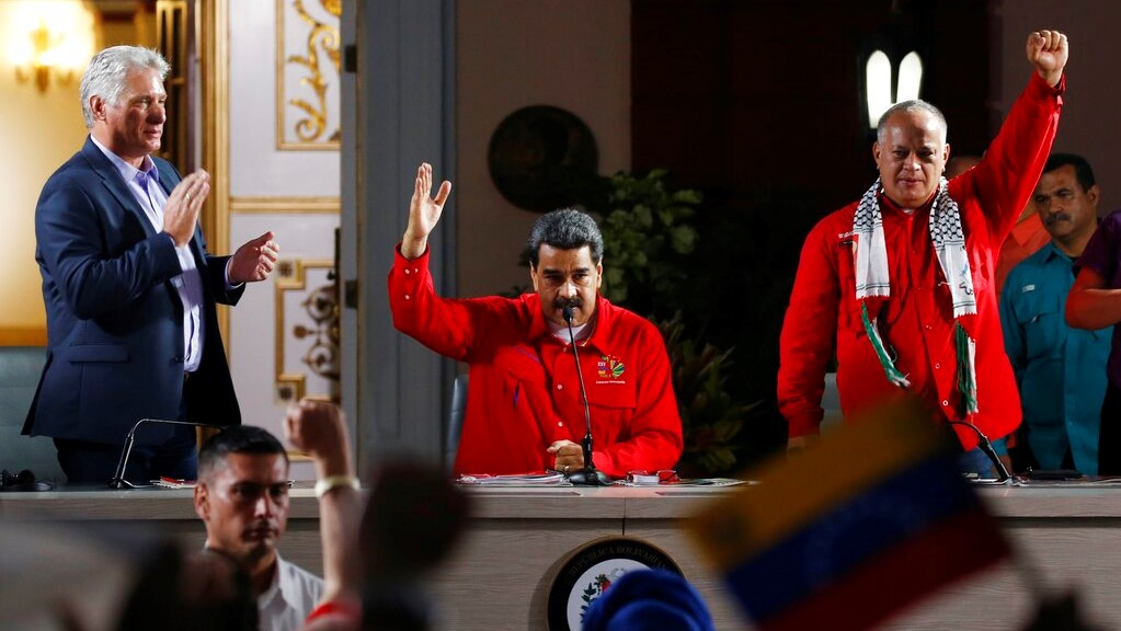 Cuba's President Miguel Diaz-Canel, left, Venezuela's President Nicolas Maduro, centre, and Venezuelan Socialist Party President Diosdado Cabello, right, attend the closing ceremony of the Sao Paulo Forum at Miraflores presidential palace in Caracas, Venezuela, Sunday, July 28, 2019. (AP Photo/Ariana Cubillos)