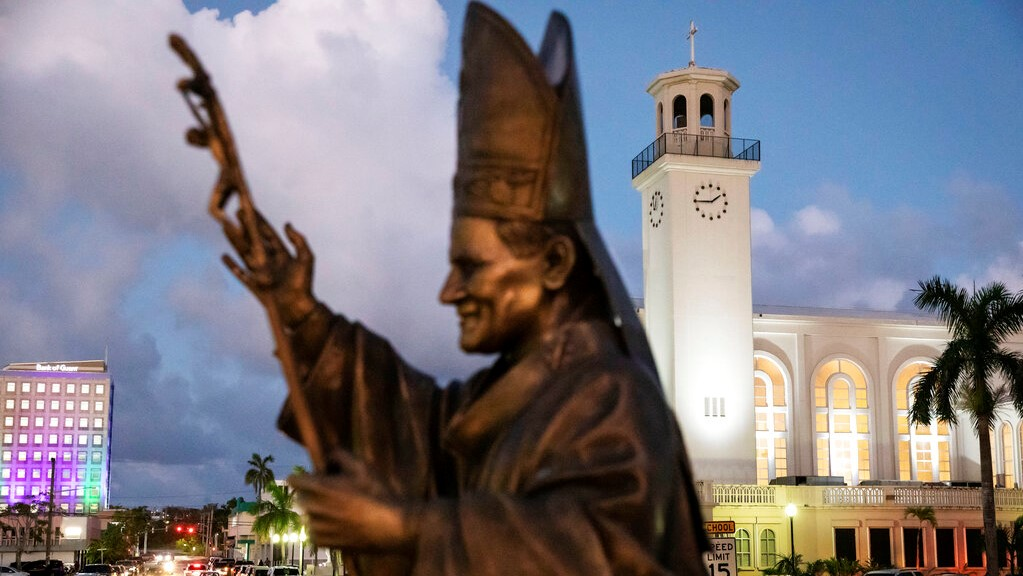 A statue of Pope John Paul II stands outside the island's main cathedral, Dulce Nombre de Maria Cathedral-Basilica, during a Mass in Hagatna, Guam, Tuesday, May 7, 2019.  (AP Photo/David Goldman)
