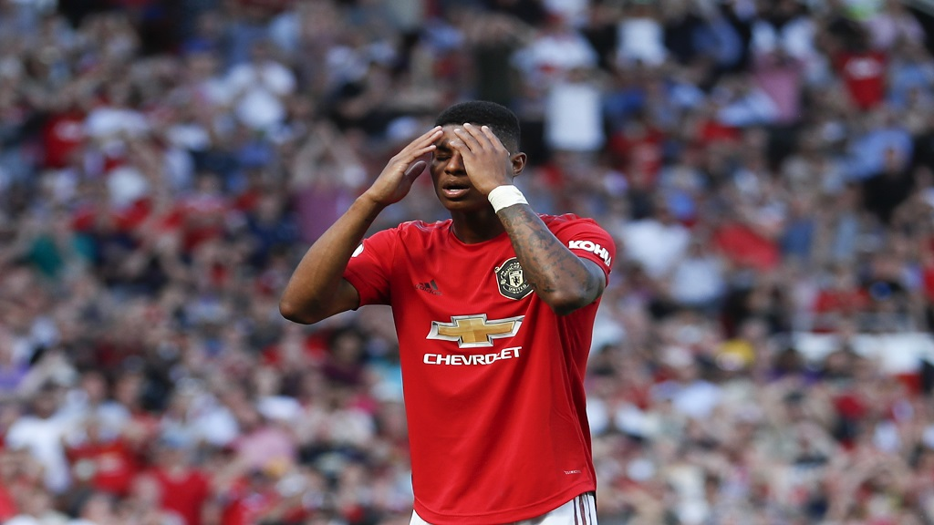 Manchester United's Marcus Rashford reacts after failing to score a penalty kick during the English Premier League football match against  Crystal Palace at Old Trafford in Manchester, England Saturday, Aug, 24, 2019. (AP Photo/Alastair Grant).
