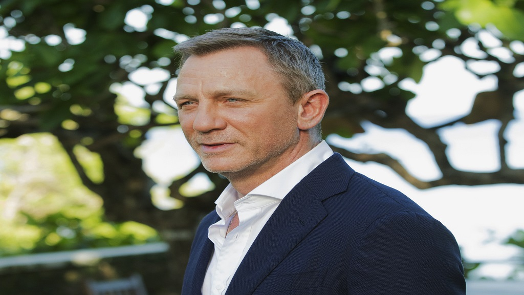 "In this April 25, 2019, file photo, actor Daniel Craig poses for photographers during the photo call of the latest installment of the James Bond film franchise, currently known as ""Bond 25,"" in Oracabessa, Jamaica. (AP Photo/Leo Hudson, File)"