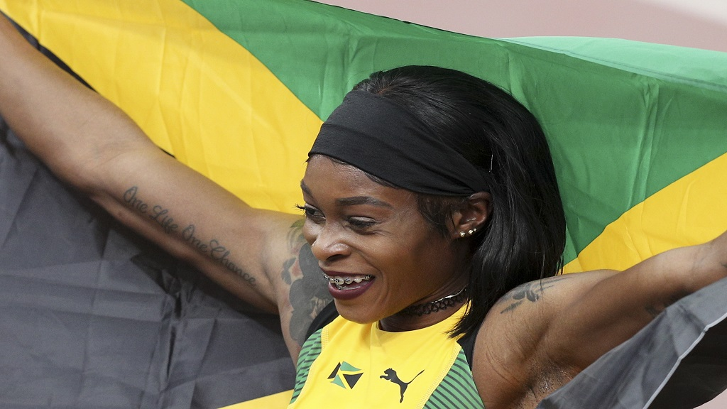 Elaine Thompson of Jamaica celebrates winning the gold medal in the women's 100m during the athletics at the Pan American Games in Lima, Peru, Wednesday, Aug. 7, 2019. (AP Photo/Martin Mejia).
