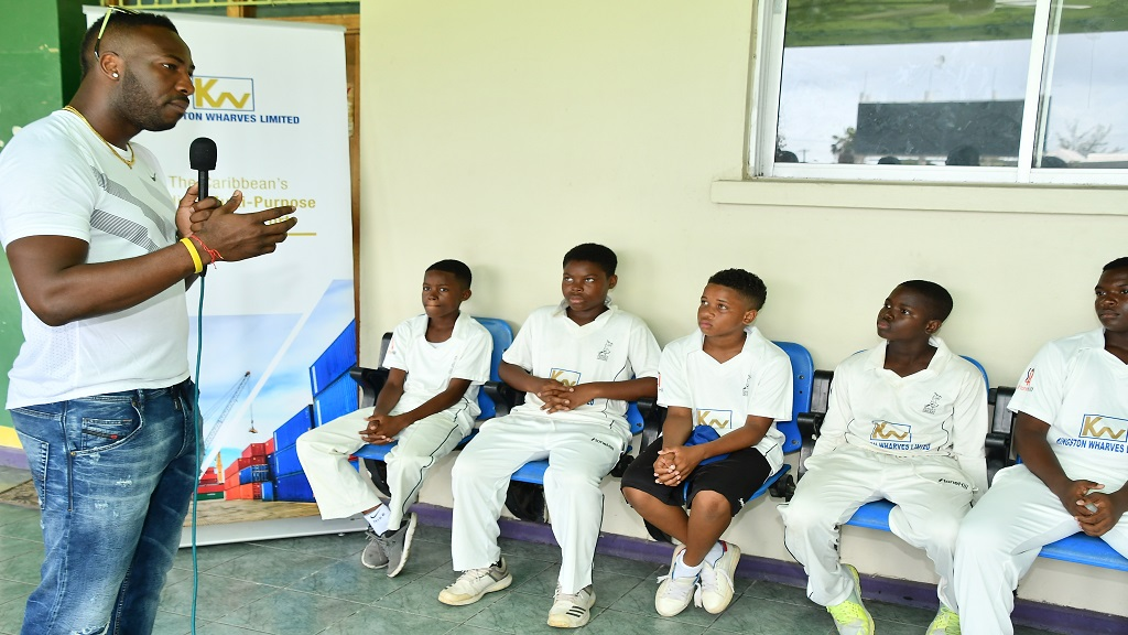 Jamaica and West Indies all-rounder Andre Russell addresses young cricketers just before the quarter-final clash of the Kingston Wharves Under-15 cricket match between Kingston and Melbourne at Emmet Park on Tuesday, August 21, 2019.