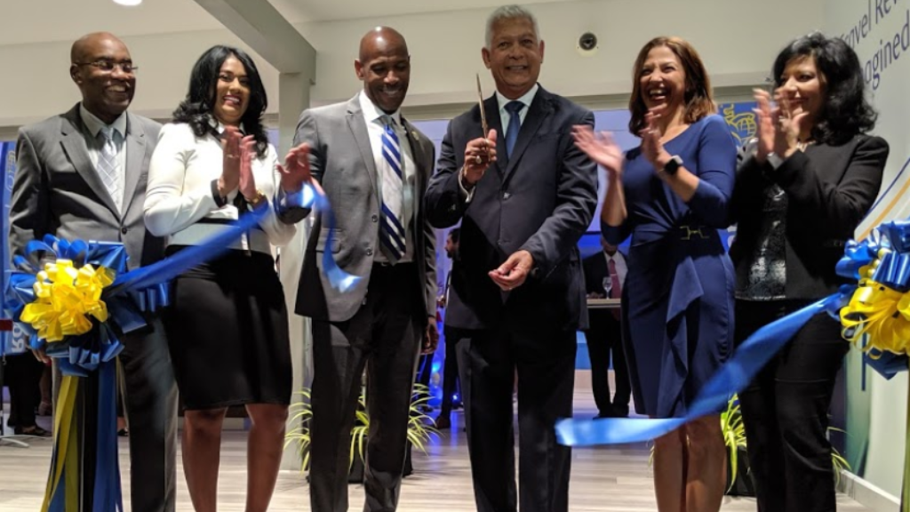 Port-of-Spain Mayor Joel Martinez cuts the ribbon, officially reopening the RBC branch at Rookery Nook, Maraval. Photo: Darlisa Ghouralal.