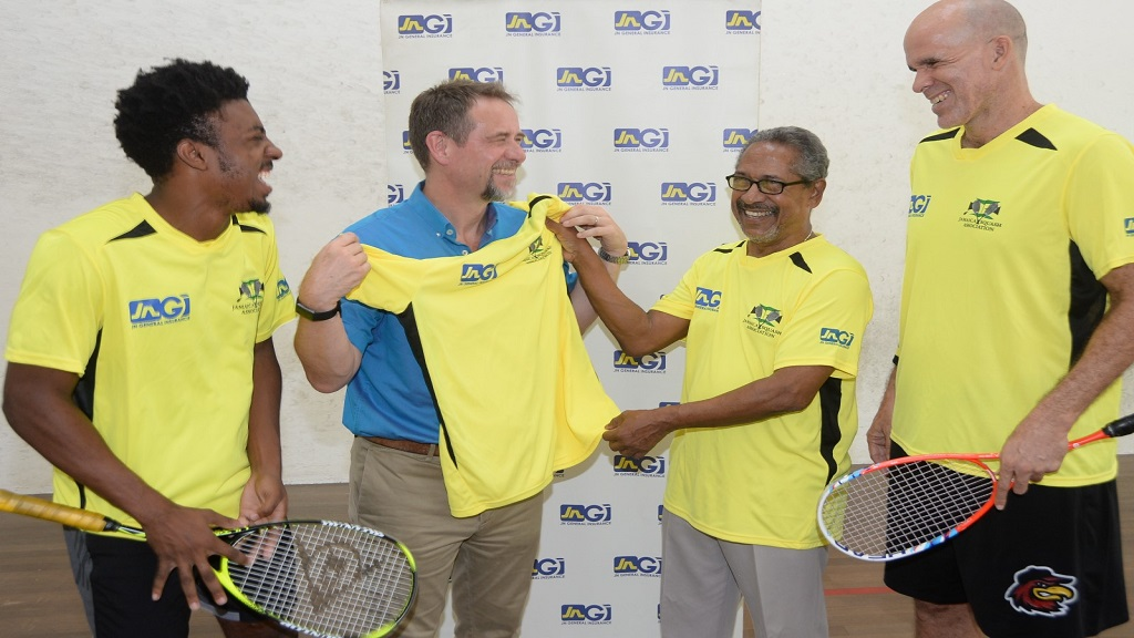 CEO of JN General Insurance, Chris Hind, (2nd left) and Team Manager, Douglas Beckford (3rd left) pose with a competition shirt during a presentation ceremony at the Liguanea Club in Kingston on Thursday, August 15 just ahead of the departure of Jamaica's squad for the 2019 Caribbean Area Squash Association's Senior Championships  in Guyana.  Also involved in the presentation are Players Tahjia Lumley (left) and Stuart Maxwell (right).