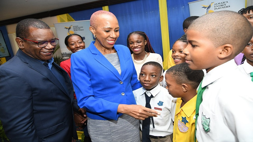 Technology minister Fayval Williams (2nd left) greets scholarship recipients at  a recent awards ceremony hosted by the Jamaica Energy Partners and West Kingston Power Partners. Sharing in the moment is the companies' CEO, Wayne McKenzie (left).