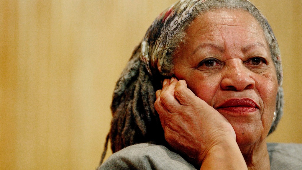 n this Nov. 25, 2005 file photo, author Toni Morrison listens to Mexicos Carlos Monsivais during the Julio Cortazar professorship conference at the Guadalajara's University in Guadalajara City, Mexico. (AP Photo/Guillermo Arias, File)