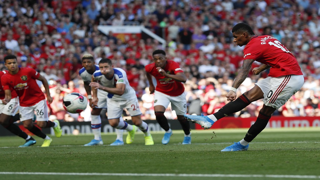 Manchester United's Marcus Rashford, right, misses a penalty kick during the English Premier League football match against Crystal Palace at Old Trafford in Manchester, England Saturday, Aug, 24, 2019. (AP Photo/Alastair Grant).