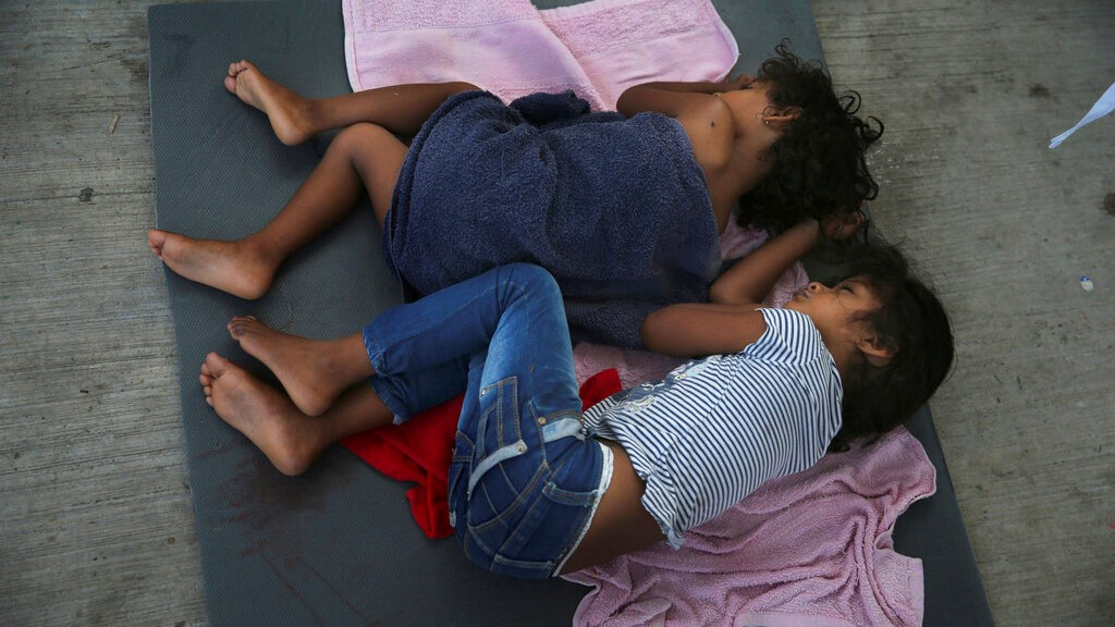 In this July 17, 2019 file photo, migrant children sleep on a mattress on the floor of the AMAR migrant shelter in Nuevo Laredo, Mexico. The American Civil Liberties Union said Tuesday, July 30, 2019 that more than 900 children have been separated from their families at the border since a judge ordered last year that the practice be sharply curtailed. The ACLU says about one of every five children separated is under 5 years old. (AP Photo/Marco Ugarte, File)