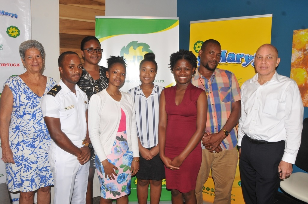 Jeffrey Hall (right), CEO of Jamaica Producers (JP) Group and Elizabeth Phillips, director of the Sydney A Phillips Scholarship Trust Fund congratulates the 2019-2020 scholarship awardees — (from left) Shando Buchanan, Shereen LaTouche, Cedella Mckie, Xandrea Roach, Natola Watt and proud father Audley Bailey, standing in for Shamona Bailey — during the presentation ceremony held at the JP Head Office recently.