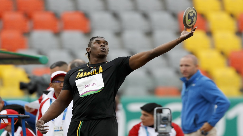Fedrick Dacres of Jamaica raises the disk in the men's discus throw competition during the athletics at the Pan American Games in Lima, Peru, Tuesday, Aug. 6, 2019. Dacres won the gold medal. (AP Photo/Fernando Llano)