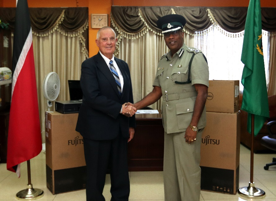 Ambassador Joseph Mondello presents Prisons Commissioner Gerard Wilson with