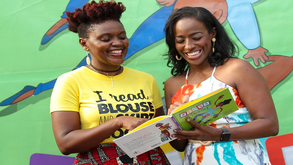 Carlette DeLeon (r) author of the #JoysOfParenting shared a joyous moment with Tanya Batson-Savage owner of publishing house Blouse and Skirt Books an imprint of Blue Banyan Books during the launch of the book held in July at the Hope Zoo in Kingston.
