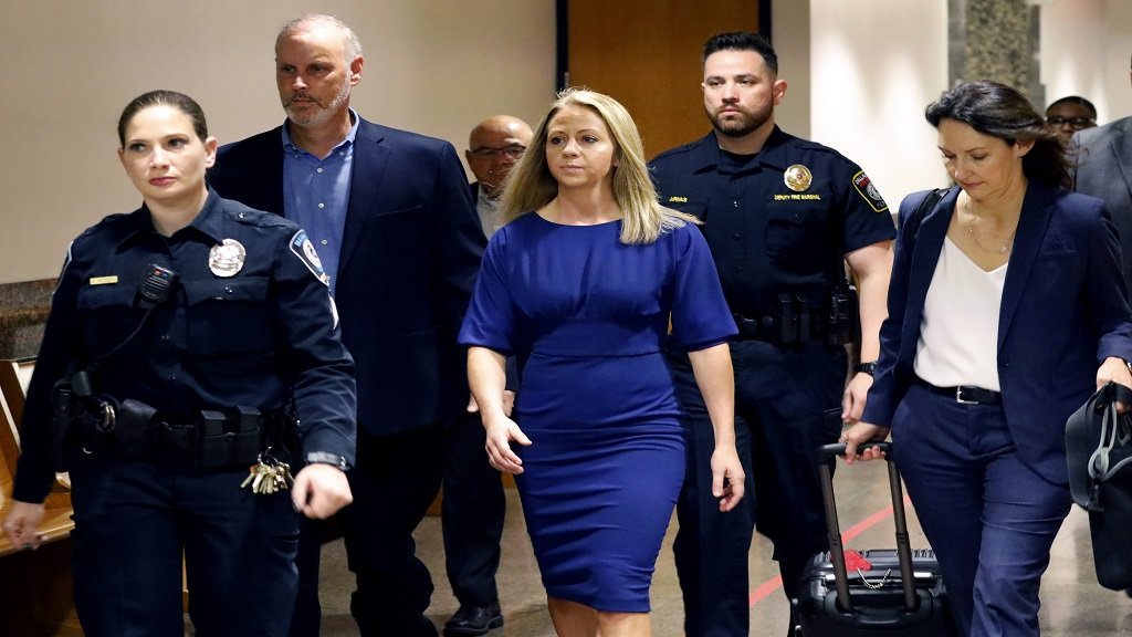 Former Dallas police officer Amber Guyger, center, arrives for the first day of her murder trial in the 204th District Court at the Frank Crowley Courts Building in Dallas, Monday, Sept. 23, 2019. (Tom Fox/The Dallas Morning News via AP, Pool)