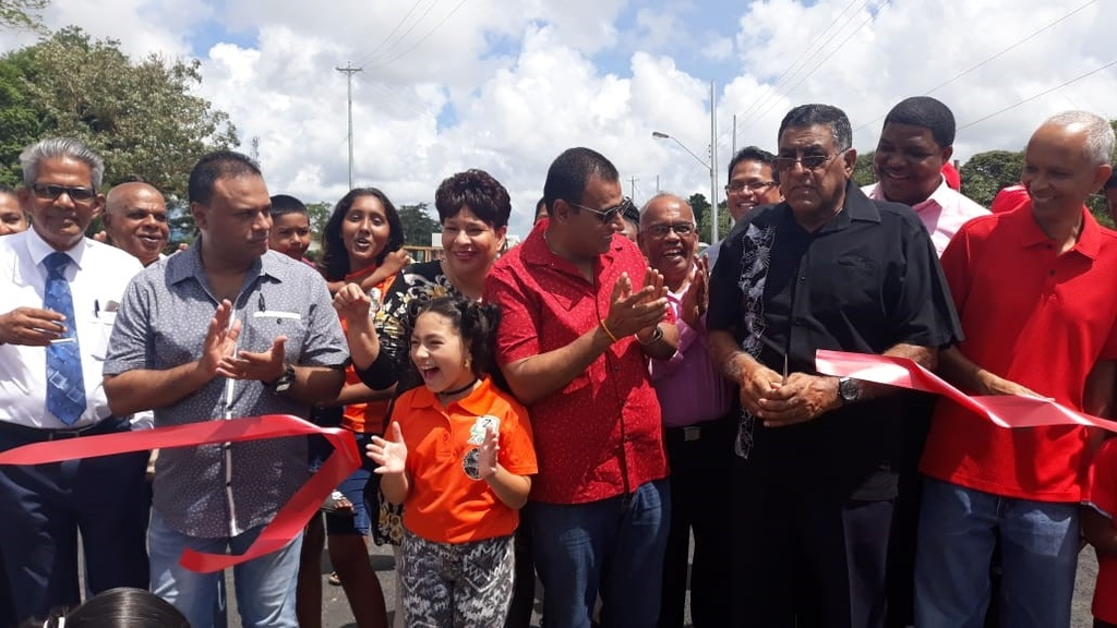Minister of Works Rohan Sinanan and Sangre Grande Regional Corporation Chair Terry Rondon cut the ribbon to open the new Cuanapo Bridge today.