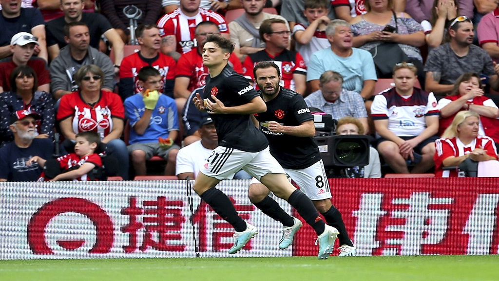 Manchester United's Daniel James, left, celebrates scoring his side's first goal of the game during their English Premier League soccer match against Southampton at St Mary's, Southampton, England, Saturday, Aug. 31, 2019. (Mark Kerton/PA via AP)